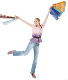 Young girl with purchases. On white background Royalty Free Stock Images