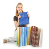 Young girl with purchases royalty free stock photography