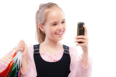 Young girl with purchases and phone Royalty Free Stock Image