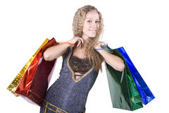 The young girl with purchases during shopping. The young beautiful girl with purchases in colour packages during shopping on a white background Stock Image