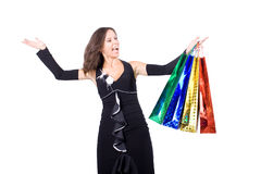 The young girl with purchases during shopping. The young beautiful girl with purchases in colour packages during shopping on a white background Royalty Free Stock Image