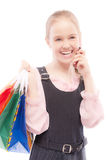 Young girl with purchases speaks by Royalty Free Stock Photos
