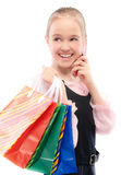 Young girl with purchases speaks by Stock Photo