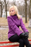 Young girl in a purple coat Royalty Free Stock Images