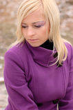 Young girl in a purple coat Stock Photo