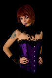 Young girl in purple corset. Isolated on black background royalty free stock photos