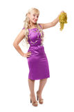 Young girl in a purple evening dress Stock Images