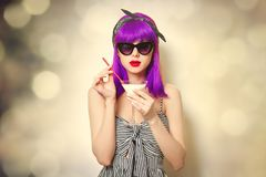 Girl with purple hair holding lemonade cocktail royalty free stock photography