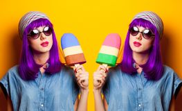 Young girl with purple hair and ice-cream toy Stock Images