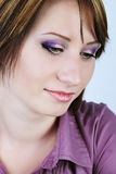 Young girl in a purple shirt with a short haircut Stock Photography