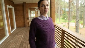 Young girl in a purple sweater and black jeans stock footage