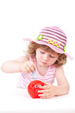 Young girl putting a euro note in her piggy bank Stock Image