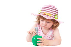 Young girl putting a euro note in her piggy bank Stock Photos