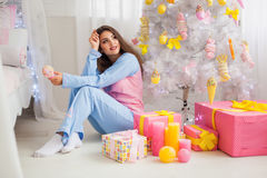 Young girl in pyjamas Stock Images