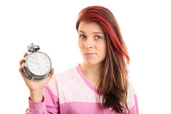 Young girl in pyjamas holding an alarm clock Stock Photography