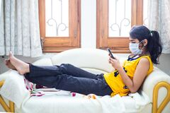 Young girl quarantined at home during World Pandemic of Coronavirus Covid-19 prevention. Stay at home, stay safe. girl with