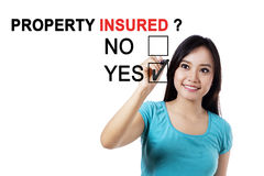 Young girl with question of property insured Royalty Free Stock Image