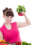 young girl with radish and pepper Royalty Free Stock Photography