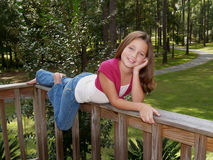 Young Girl on Railing Stock Images