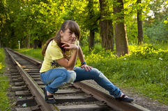 Young girl on the railroad. Royalty Free Stock Photography