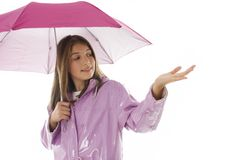Young girl in a raincoat and holding an umbrella Stock Photography