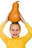 The young girl raised her pumpkin over his head Royalty Free Stock Images