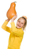 The young girl raised her pumpkin over his head Royalty Free Stock Photo
