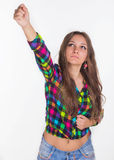 Young girl raises her hand up Stock Image