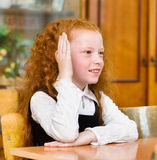 Young girl raising hand knowing the answer to the question.  royalty free stock images