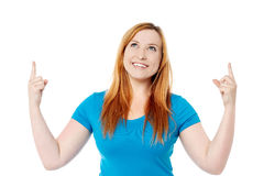 Young girl raising her arms and looking up Stock Images