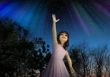 Young Girl Reaching for the Stars in Hope. 3d illustration of a young girl reaching for the stars in hope and full of dreams Royalty Free Stock Photo
