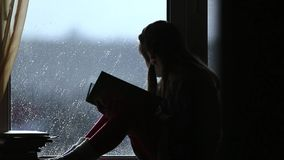 Young girl read the book stock video