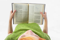 Young girl read the book on white Royalty Free Stock Photo