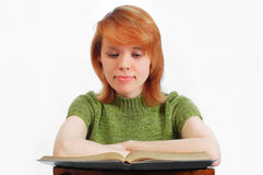 Young girl read the book on white. Young girl read the book royalty free stock photography