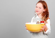Young Girl Read to Cook Royalty Free Stock Photos