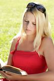 Young girl reading Stock Images