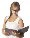 Young girl reading. Young girl in white with glasses reading Royalty Free Stock Photos