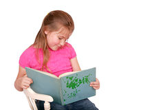 Young girl reading. Young girl in pink reading isolated on white Stock Image