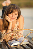 Young girl reading the Bible on a park bench Royalty Free Stock Photography