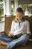 Young Girl Reading Book Stock Image