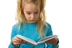 Young girl is reading a book Stock Images