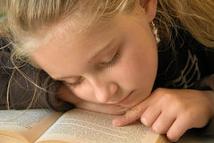 Young girl reading book Stock Photos