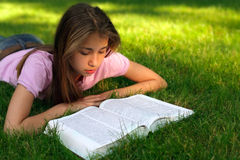 Young girl reading the book Stock Photography