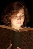 Young Girl reading a book. Young girls reading a book Stock Images