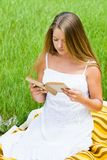 Young girl reading book Stock Photo