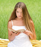 Young girl reading book Stock Images