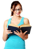 Young girl reading a book. Royalty Free Stock Photography