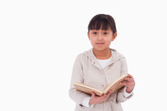 Young girl reading a book Royalty Free Stock Photo