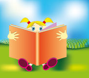 Young girl reading a book. Little girl reading a book Royalty Free Stock Image