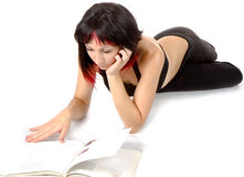 Young girl reading a book Royalty Free Stock Images